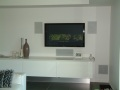 In-wall speaker system with wall mount TV